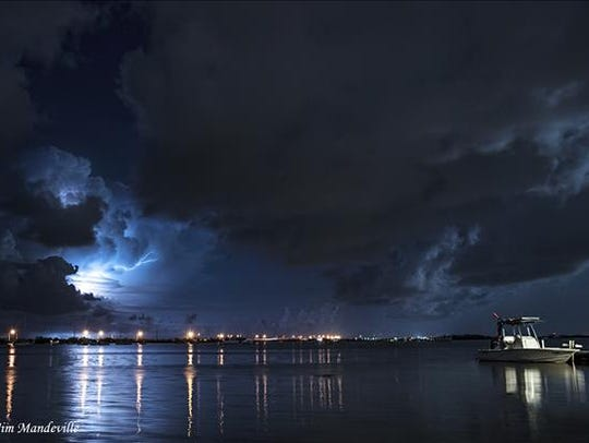 Lightning storm over water.