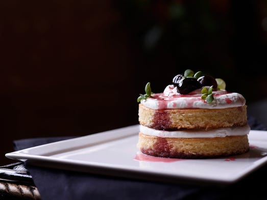 Olive oil cake with macerated cherries and micro mint