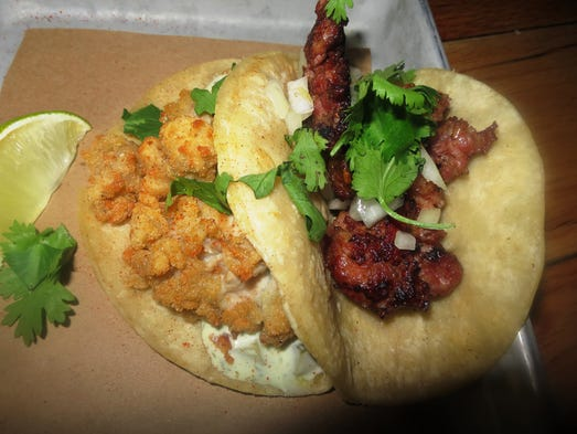 Fried oyster and spicy chorizo tacos. Larry Olmsted for USA TODAY