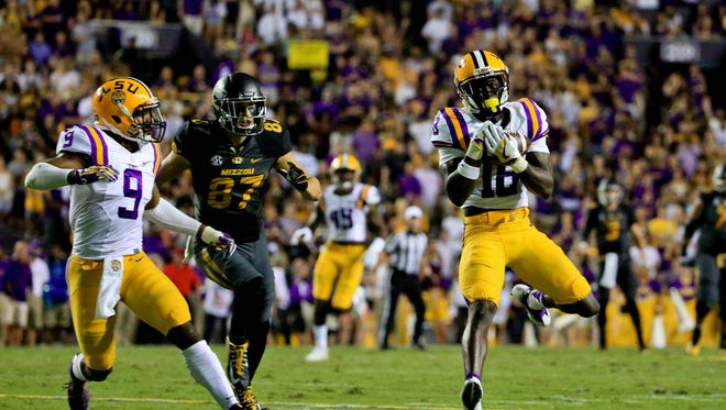 LSU Tigers cornerback Tre'Davious White (18) intercepts a pass against the Missouri Tigers during the first half of a game at Tiger Stadium.