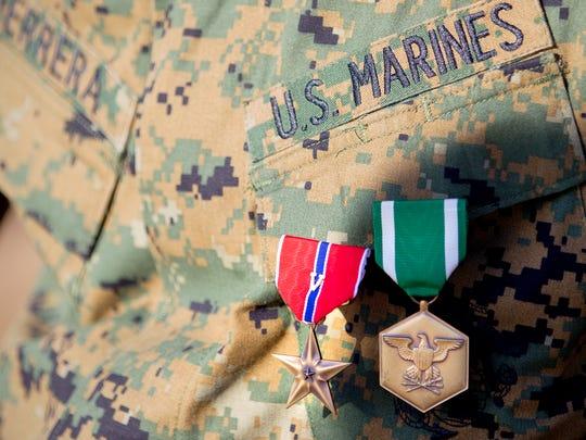 Marine Capt. Derek Herrera wears his Bronze Star during his retirement ceremony at Camp Pendleton, Calif., Friday.