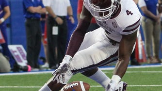 Mississippi State's Gerri Green (4) attempts to pick up a blocked punt in the end zone. Mississippi State and Louisiana Tech played in a college football game on Saturday, September 9, 2017 at Joe Aillet Stadium in Ruston, La. Photo by Keith Warren (Mandatory Credit)
