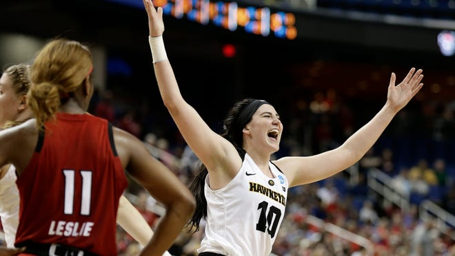 Iowa's Megan Gustafson (10) reacts as she leaves the court as North Carolina State's Kiara Leslie (11) looks on during the second half of a regional women's college basketball game in the NCAA Tournament in Greensboro, N.C., Saturday, March 30, 2019. (AP Photo/Gerry Broome)