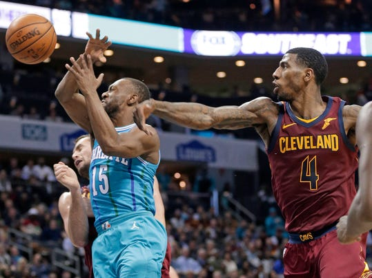 Charlotte Hornets' Kemba Walker (15) is fouled by Cleveland Cavaliers' Iman Shumpert (4) during the first half of an NBA basketball game in Charlotte, N.C., Wednesday, Nov. 15, 2017. (AP Photo/Chuck Burton)