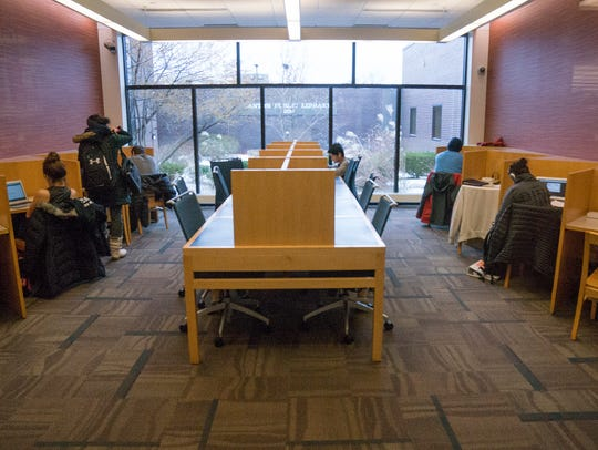 The center workspaces are reclaimed from a study room