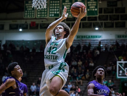 New Castle's Jared Heard goes up for a shot against