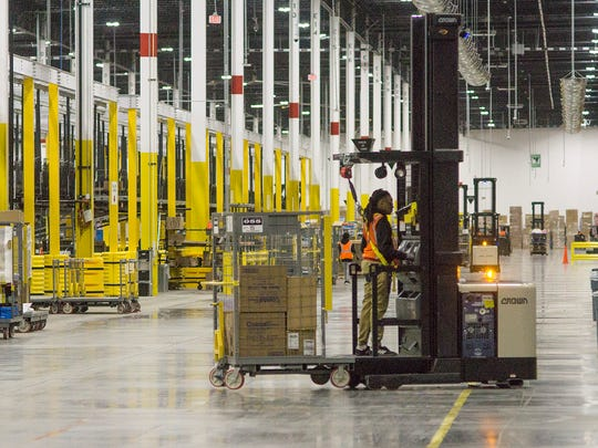 The individual products are picked by an employee driving hydrogen fuel cell-powered hi-los that lift the operator to the top of the 28 foot tall shelves.
