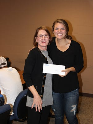Jordan Mckenzie Baylor (right) received her scholarship check from Donna Foster.
