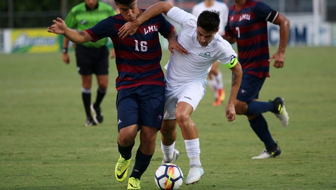 Enrique Bustamante, left, and FGCU's Dylan Sacramento fight for possession during the FGCU's home opener against Loyola Marymount on Friday, Sept. 15, 2017.