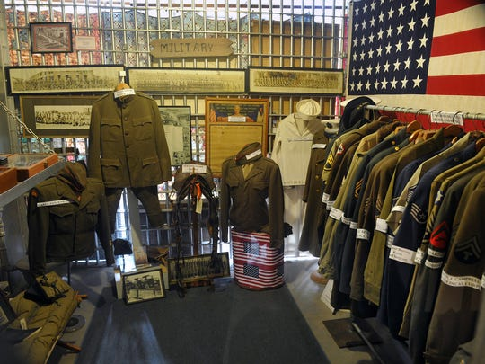 Several uniforms, photographs, medals and other artifacts from local veterans make up the military displays in the cells of the Clay County Jail Museum in Henrietta.