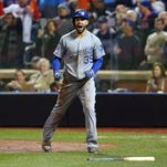 Eric Hosmer reacts after scoring the tying run in the ninth inning.