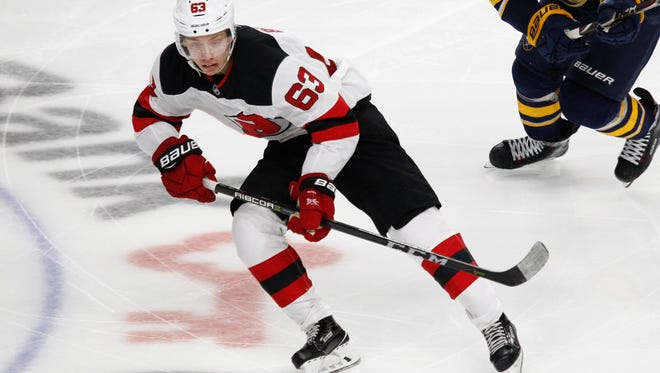 New Jersey Devils forward Jesper Bratt (63) skates during the third period of an NHL hockey game against the Buffalo Sabres, Monday Oct. 9, 2017, in Buffalo, N.Y. (AP Photo/Jeffrey T. Barnes)