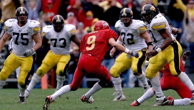 Adam Runk looks for running room after his interception sealed a 2001 victory over visiting Iowa.