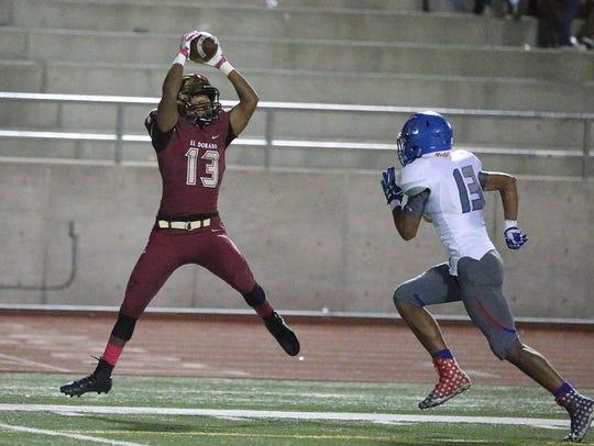 El Dorado wide receiver Corey McCoy, 13, leaps for