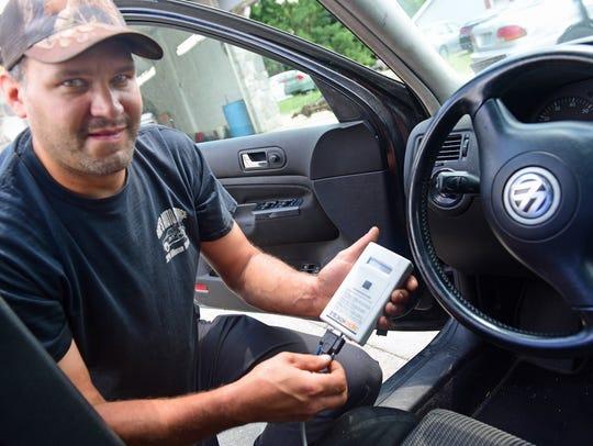 George Mandrick, a mechanic at Dave's Trucking, displays