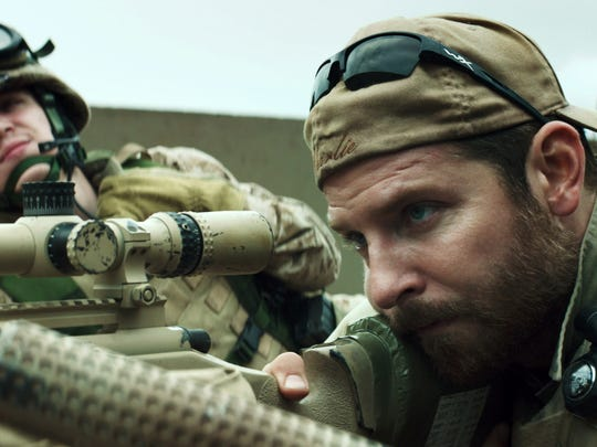 Bradley Cooper (right, with Kyle Gallner) plays  Chris Kyle, the most prolific sniper in U.S. history.