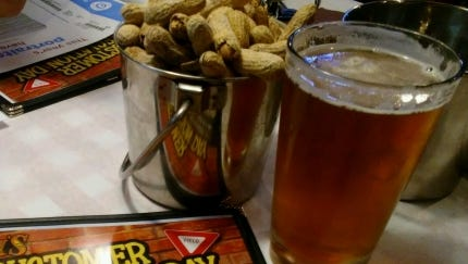 At Cody's Original Roadhouse, you get  roasted peanuts dished up in small pails on the table. Shortly after ordering, we received fresh yeast rolls with sweet cream butter and servers toss the endless house salad tableside dressed with garlic ranch dressing.