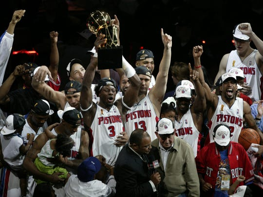 Ben Wallace raises the Larry O'Brien Championship Trophy after the Pistons clinched the NBA title with a 100-87 win over the Lakers in Game 5 of the NBA Finals on June 15, 2004 at the Palace.