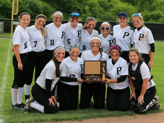 Plymouth's varsity softball team celebrates after defeating