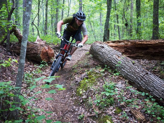 A mountain biker weaves through the Chequamegon-Nicolet National Forest on the CAMBA trail system near Cable.