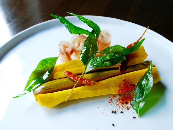 Spicy turmeric squash pickles, sweet and salty lardo,