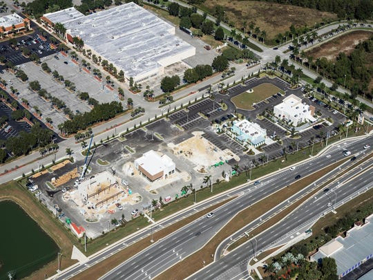 Restaurant Row is under construction along Collier Boulevard on the edge of Freedom Square shopping center. From left, Texas Roadhouse, Chipotle Mexican Grill and Pei Wei Asian Diner, future sports bar, Pollo Tropical drive-thru and Starbucks drive-thru.