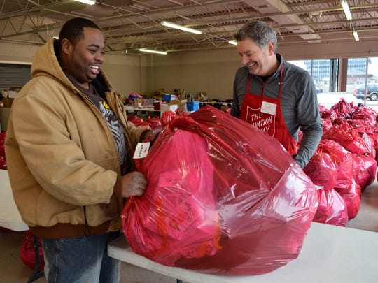 Jim Charron gives a large bag of toys and gifts to