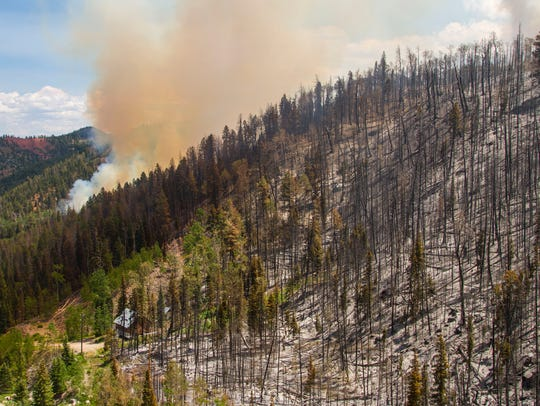 The Brian Head fire continues to burn along Highway