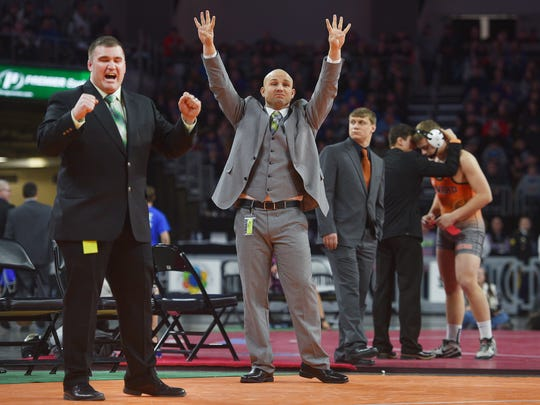 "Pierre coach Shawn Lewis (center) cheers after Pierre's Will Turman wins his match against RC Steven's Spencer Stockman in the Class ""A"" 2018 SDHSAA State Wrestling Championships Saturday, Feb. 24, at the Denny Sanford Premier Center in Sioux Falls."