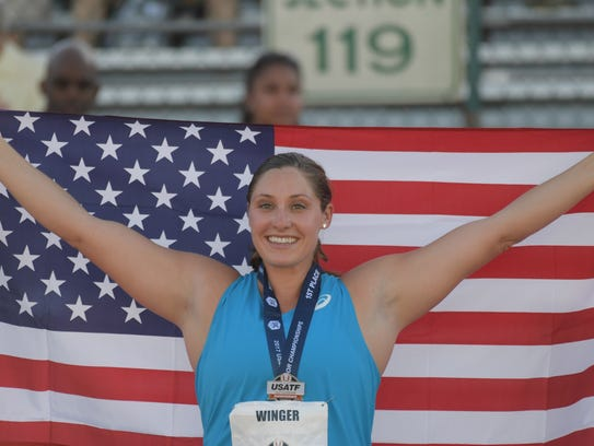 Kara Winger poses with United States flag after winning