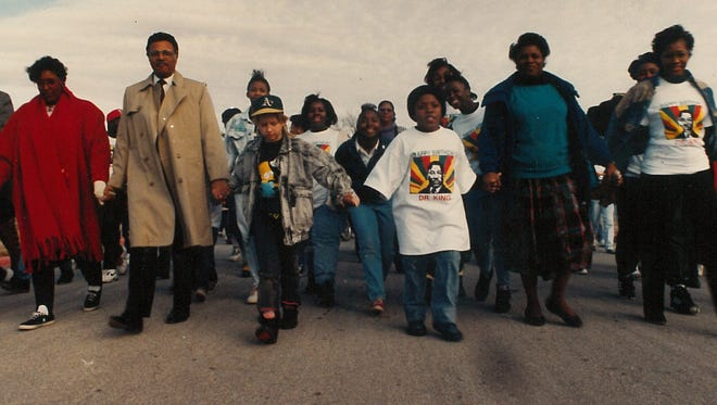 The Rev. Leo F. Scott, fourth from the left in overcoat, joins others in a march to honor slain civil rights leaders Martin Luther King Jr. in January 1991. A month earlier, the city of Abilene recognized the third Monday in January as a holiday honoring King.