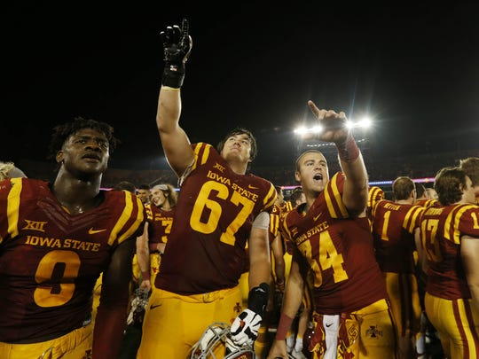 Iowa State wide receiver Quenton Bundrage (9), offensive lineman Jake Campos (67) and deep snapper Austin Fischer (34) celebrate Saturday, Sept. 5, 2015, following their 31-7 win over Northern Iowa at Jack Trice Stadium in Ames.