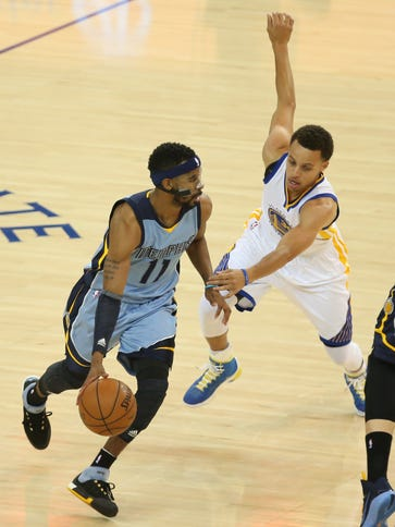Memphis Grizzlies guard Mike Conley (11) drives in