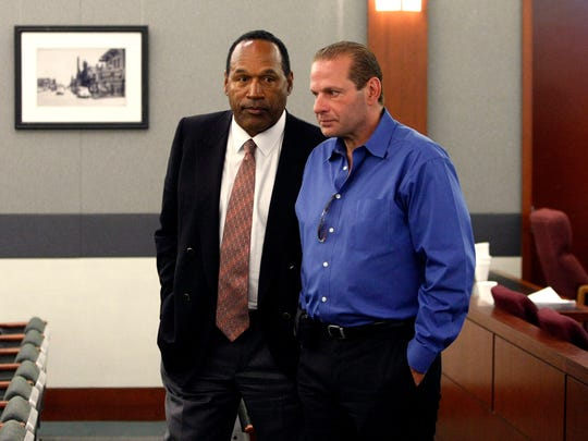 O.J. Simpson, left, and his friend Tom Scotto, of Naples, talk after the second day of jury selection for Simpson's trial at the Clark County Regional Justice Center on Sept. 9, 2008, in Las Vegas. Simpson was later convicted of charges in an attempted robbery at the Palace Station Hotel & Casino in September 2007.