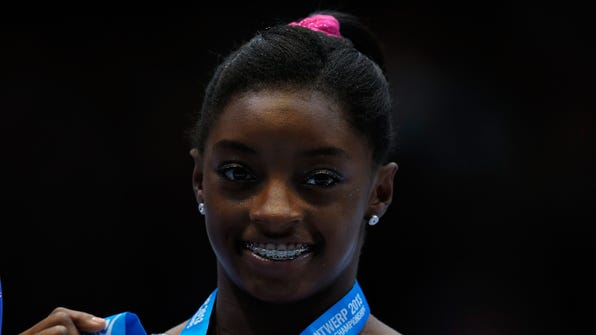 Simone Biles of the United States poses after winning the Bronze medal in the Women's balance beam final at theArtistic Gymnastics World Championships. Biles was the target of racially insensitive remarks made by Italian gymnast Carlotta Ferlito.