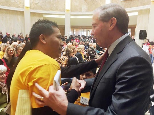 Sen. Tom Udall, D-N.M, right, speaks to an immigrant