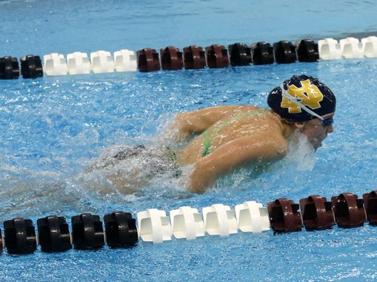 Notre Dame junior Catherine Craig swims the butterfly during practice Wednesday at Elmira High School.