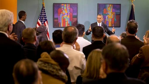 President Barack Obama is applauded as he arrives to speak about his recent executive actions on immigration, Tuesday, Dec. 9, 2014, at Casa Azafran in Nashville, Tenn. (AP Photo/Jacquelyn Martin)