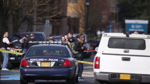 The scene in North Portland where a shooting occurred near Rosemary Anderson High School on Dec. 12, 2014.  A shooter wounded two boys and a girl outside the high school Friday in what may be a gang-related attack, police said.