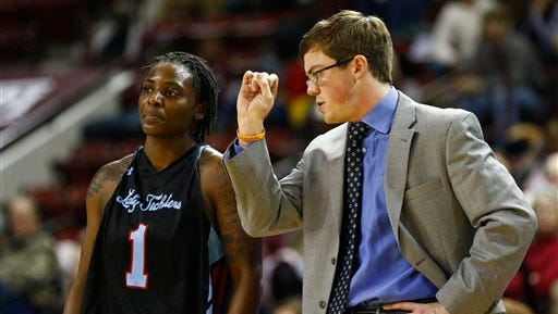 Louisiana Tech basketball coach Tyler Summitt talks with guard Kelia Shelton (1) in the second half of their NCAA college basketball game against Mississippi State in Starkville, Miss., Thursday, Dec. 11, 2014. Mississippi State won 81-77. (AP Photo/Rogelio V. Solis)