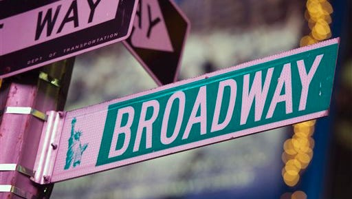 In this file photo, a Broadway street sign is seen in Times Square in New York. Theater-goers were very generous to Broadway producers this holiday season, with 19 of 36 shows breaking the $1 million mark and almost 30,000 more people in the seats than last Christmas. The Broadway League said Monday that Broadway shows pulled in $40,843,987 for the week ending Sunday, better than the same week last year when 30 shows attracted $38,783,854.
