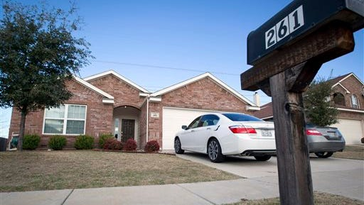 This Monday photo shows the home where officers responding to a report of a suicide attempt found four people dead in Crowley, Texas Sunday. Crowley Police Chief Luis Soler said in a news conference Sunday night that a 9-year-old who was inside the home called a relative and told her that a man there was injured after attempting to kill himself.