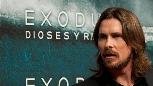"""In this file photo, English actor Christian Bale poses for photographers during the premiere of the film """"Exodus"""" in Madrid. Egypt on Sunday, Dec. 28, said it banned Ridley Scott's biblical epic """"Exodus: Gods & Kings"""" because the Hollywood blockbuster distorts Egypt's history and presents a """"racist"""" image of Jews. The Culture Ministry explained its decision for the first time in a statement issued a few days after the ban was announced."""