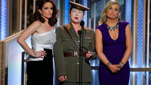 In this image released by NBC, Tiny Fey, from left, Margaret Cho and Amy Poehler speak at the 72nd Annual Golden Globe Awards on Sunday at the Beverly Hilton Hotel in Beverly Hills, Calif. (AP Photo/NBC, Paul Drinkwater)