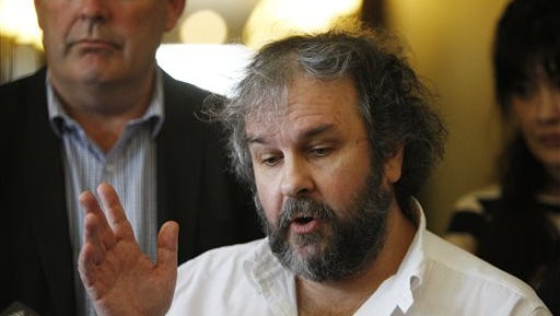 """Movie director Peter Jackson talks to reporters at an event to promote the New Zealand film industry on Wednesday in Wellington, New Zealand. Jackson said he's getting some much-needed rest after completing his """"Hobbit"""" trilogy."""
