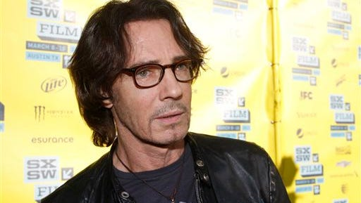 """In this file photo, actor-singer Rick Springfield attends a screening of his movie """"Sound City"""" during the SXSW Film and Music Festival, in Austin, Texas. A retrial has begun in the injury lawsuit filed by a woman who says Springfield fell on her during a 2004 concert at the New York State Fair. The Post-Standard of Syracuse reports that Springfield became emotional and cried while testifying Tuesday in state Supreme Court."""