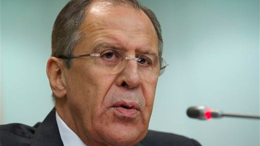Russia's Foreign Minister Sergey Lavrov speaks at an annual news conference on Russia's foreign policy issues in the Foreign Ministry headquarters in Moscow Wednesday, Jan. 21, 2014. (AP Photo/Ivan Sekretarev)