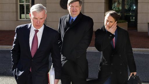 New York Times reporter James Risen, center, leaves federal court in Alexandria, Va., Monday Jan. 5, 2015, where he was expected to testify to see what evidence he may offer in the case of a former CIA officer accused of leaking classified information. Federal prosecutor have said that Risen is a critical witness in they case against ex-CIA officer Jeffrey Sterling. (AP Photo/Cliff Owen)