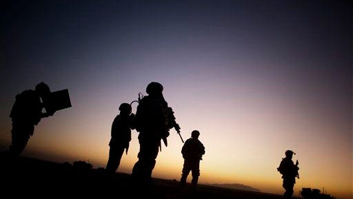 U.S. soldiers patrol the outskirts of Spin Boldak, near the border with Pakistan, about 100 kilometers (63 miles) southeast of Kandahar, Afghanistan.