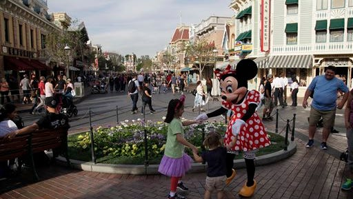 Minnie Mouse dances with visitors at Disneyland Jan. 22 in Anaheim, Calif. A major measles outbreak traced to Disneyland has brought criticism down on the small but vocal movement among parents to opt out of vaccinations for their children.